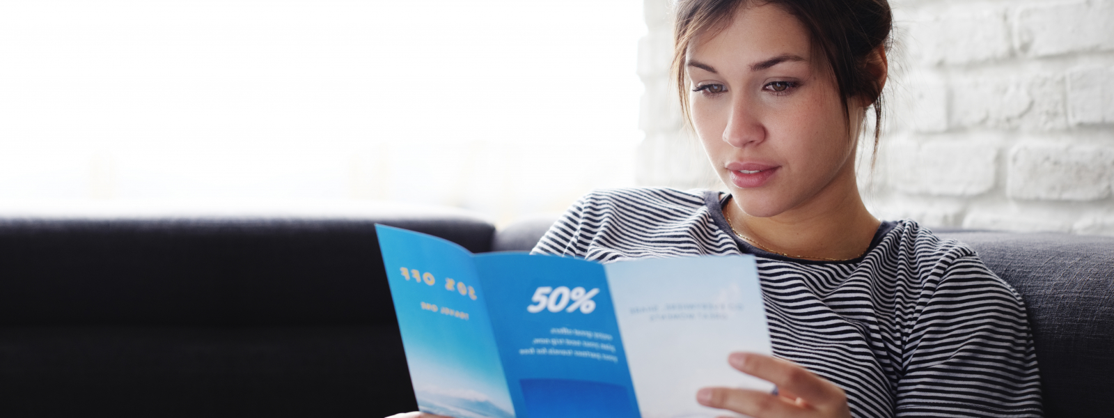 girl reading direct mail
